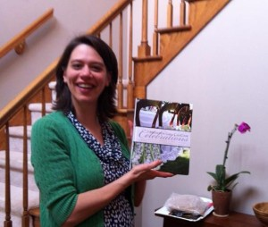 Amy Gingerich, Editorial Director at MennoMedia is all smiles upon receiving the just published Mennonite Girls Can Cook Celebrations.