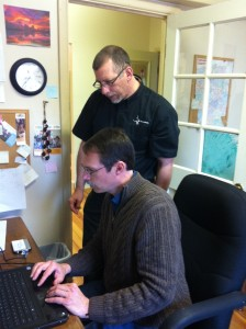 Wayne Gehman and Chet Miller Eshleman look for pictures of congregational activity at LifeBridge Community Church.