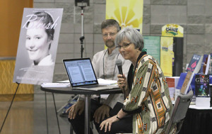 Shirley Showalter reads from her soon to be released memoir Blush while Ervin Stutzman looks on.