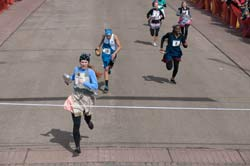Summer Parsons crosses the finish line Mar. 4, 2014, to win the Liberal leg of the International Pancake Day race in 63.5 seconds.