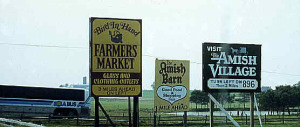 Signs to Amish tourist sites in Lancaster County, Pennsylvania.