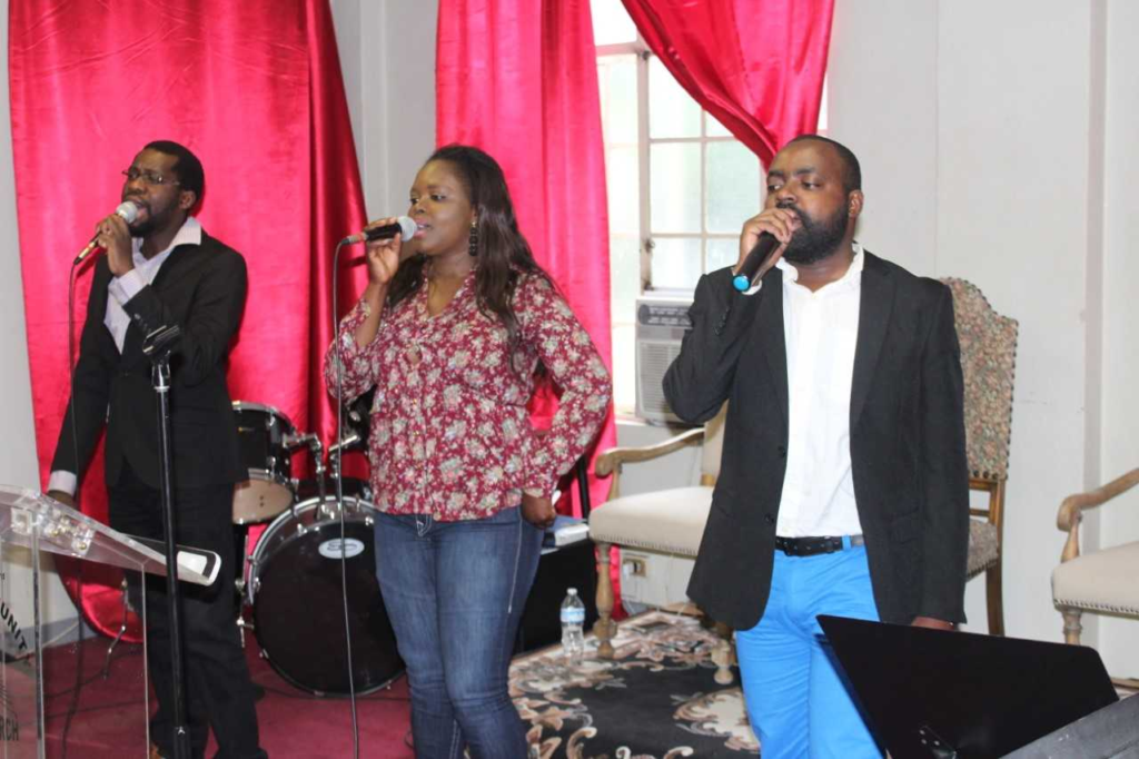 Singers (left to right) Herve Nkwansambu, Stockwell Massamba, and Tom Massamba of Wholicare Community Missionary Church (Pasadena, CA)